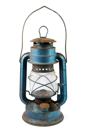 Old blue rusty lantern over white photo