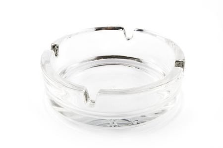 quiting smoking: Empty glass ash tray on a white background Stock Photo
