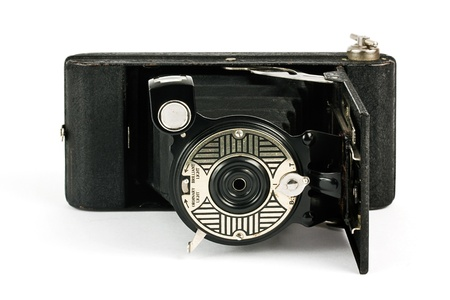 Antique fold away camera on a white background photo