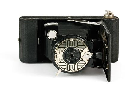 folding camera: Antique fold away camera on a white background