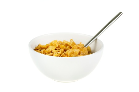 Bowl of cereal with spoon on a white background