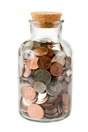 coin silver: Glass bottle full of coins on white