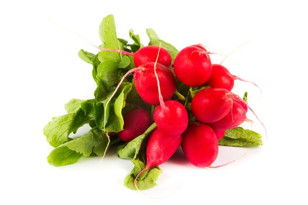 Bunch of organic radishes on a white background