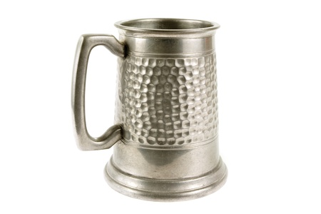 Pewter old tankard on a white background