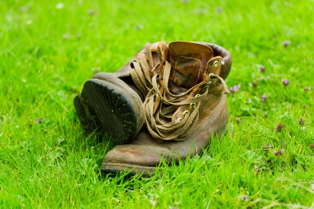 Pair of old worn boots in the grass Stock Photo - 14596462
