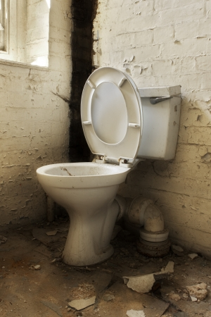 Broken old abandoned dirty toilet bowl photo