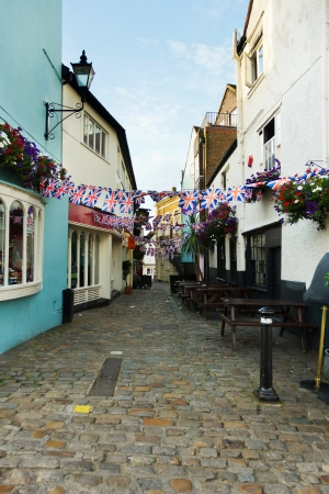 typically english: Typically English cobbled street decorated with Union Jack bunting