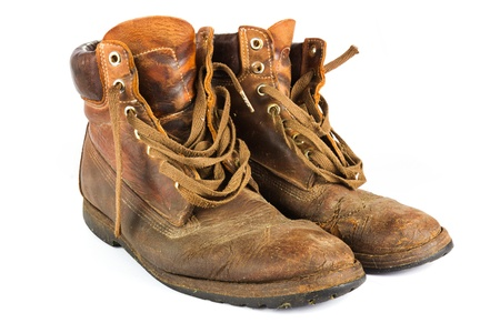 Pair of old worn brown leather work boots on white Stock Photo - 14993977