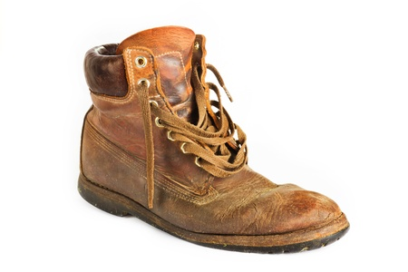 work boots: Old worn brown leather work boot on white