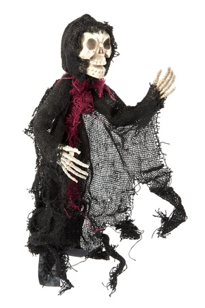 Scary Halloween grim reaper skeleton figure on white photo