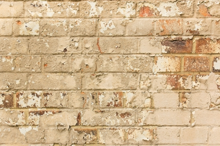 crumbling: Aged crumbling brick wall background