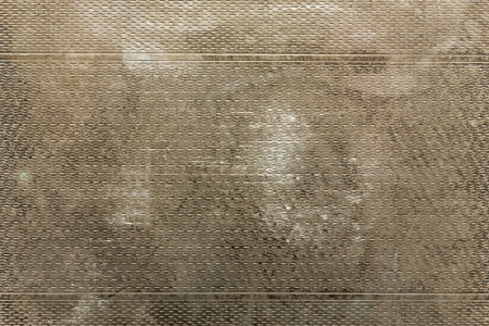 antiqued: Tarnished grungy aged patterned metal background Stock Photo