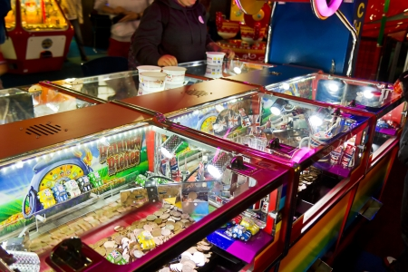 BRIGHTON, UK-SEPTEMBER 1st, 2012  Someones plays on a Penny pusher game at an arcade hall on Brightons famous pier