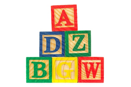 Tower of ABC wooden learning blocks over white