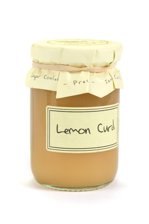 Jar of home made lemon curd over white Stock Photo