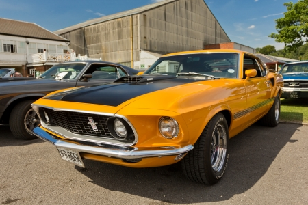 WEYBRIDGE, SURRY, UK - AUGUST 19  An imacculate orange 1969 Ford Mustang Shelby on show at the annual Brooklands Motor Museum Mustang Meet in August 2012