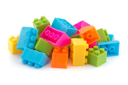 building plans: Small pile of colorful childrens building bricks on white Stock Photo