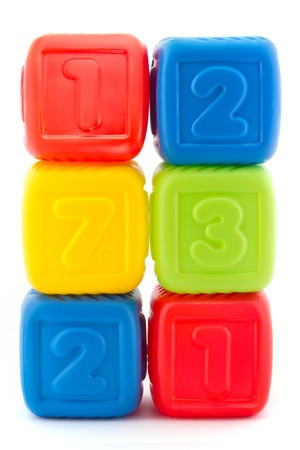 Tower of six colorful building blocks on white
