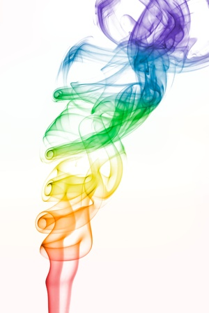 Rainbow colored smoke pattern on white photo