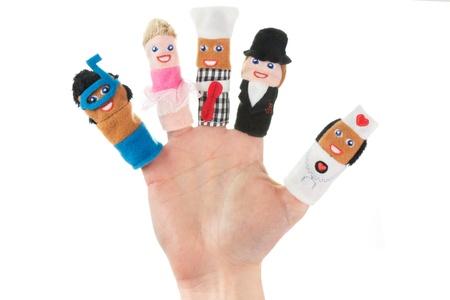 Hand holding five finger puppets (scuba diver, ballerina, chef, nanny, nurse)