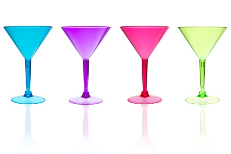 4 different color martini cocktail glasses on white