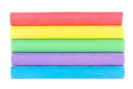 Line of different color chalks on a white background