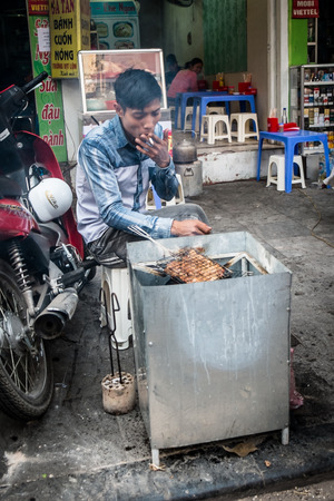 HANOI, VIETNAM, JANUARY 27  Vietnamese man cooking on the street  A common sight in the countries capital city Hanoi  In January 2014