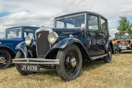 farm shop: WINDSOR, BERKSHIRE, UK- Augsut 4, 2013: A black Austion Ten Classic car on show at Windsor Farm Shop International Classic Car Show in August 2013 Editorial