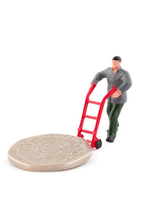minature: Minature figure moving a coin over a white background Stock Photo