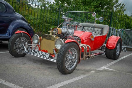 WEYBRIDGE, SURRY, UK - AUGUST 18:  1920s red Ford Model T on show at the annual Brooklands Motor Museums Mustang and Anything American Day in August 2013 Editorial