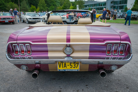WEYBRIDGE, SURRY, UK - AUGUST 18: Purple and gold Classic Ford Mustang cabriolet rear view on show at the annual Brooklands Motor Museums Mustang and Anything American Day in August 2013