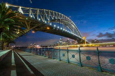 SYDNEY, AUSTRALIA- JANUARY 5, 2015: The iconic Sydney Harbour Bridge with Sydney Opera House in the background at dusk on a January evening, 2015 Editorial
