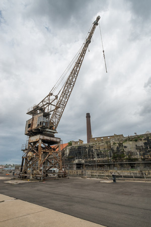 disused: Rusty disused crane on Cockatoo Island docks in Sydney.