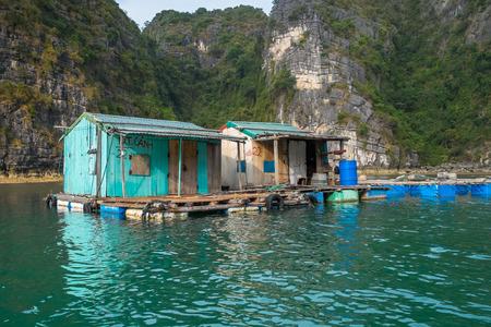HALONG BAY, VIETNAM - JANUARY 28: Run down houses in a floating village on January 28, 2014 in Halong Bay, Vietnam.