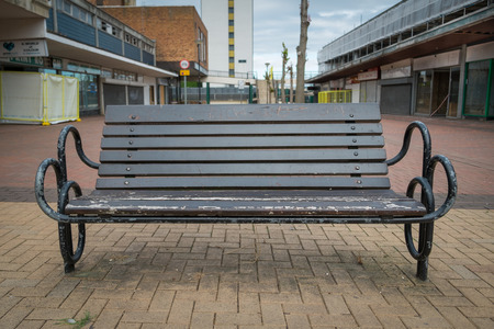 BRACKNELL, UK - AUGUST 11, 2013: A bench in an empty highstreet in the Berkshire town of Bracknell. Awaiting demolition to make way for re-development.