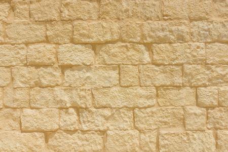 sandstone: Sandstone brick wall background. Stock Photo