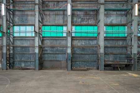 corrugated iron: Corrugated iron wall in a warehouse. Stock Photo