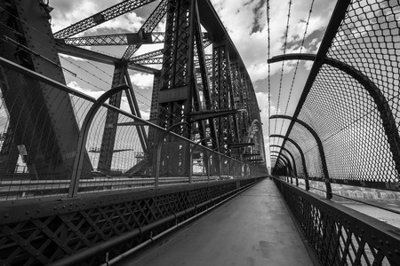 SYDNEY, AUSTRALIA - November 23, 2014: Black and white view from the walkway on the famous Sydney Harbour Bridge in November 2014. Editorial