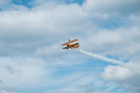 ASCOT, UK - AUGUST 16, 2014: Wing walking display at the Red Bull Air Race in Ascot, August 16, 2014.