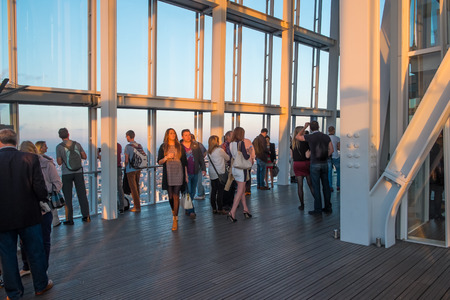 LONDON, UK - OCTOBER 3, 2014: Visitors on the viewing platform in The Shard, the tallest building in London at sunset in October 2014. Editorial