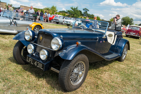 WINDSOR BERKSHIRE UK AUGUST 3 2014: ABlue Morgan Classic car on show at a Classic Car Show in August 2013.
