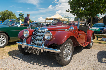 WINDSOR BERKSHIRE UK AUGUST 3 2014: Classic MG TF in red on show at a Classic Car Show in August 2013.