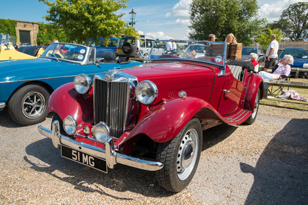 WINDSOR BERKSHIRE UK AUGUST 3 2014: A Red Classic MG TF on show at a Classic Car Show in August 2013.