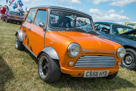 WINDSOR BERKSHIRE UK AUGUST 3 2014: An Orange Classic Mini on show at a Classic Car Show in August 2013. Editorial