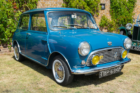 WINDSOR BERKSHIRE UK AUGUST 3 2014: A Blue Classic Austin Mini on show at a Classic Car Show in August 2013. Editorial
