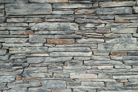 Background texture of a decorative slate stone wall.