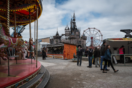 WESTON-SUPER-MARE, UK - SEPTEMBER 3 2015: The merry go round and castle at Banksys Dismaland Bemusement Park. A five week show in the seaside town of Weston-Super-Mare.