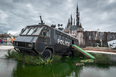 WESTON-SUPER-MARE, UK - SEPTEMBER 3 2015: A police riot van in Water Cannon Creek at Banksys Dismaland Bemusement Park. A five week show in the seaside town of Weston-Super-Mare. Editorial