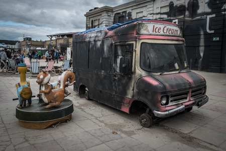 WESTON-SUPER-MARE, UK - SEPTEMBER 3 2015: Burnt out ice cream van at Banksys Dismaland Bemusement Park. A five week show in the seaside town of Weston-Super-Mare.