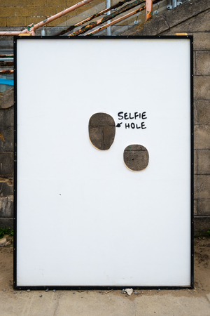 WESTON-SUPER-MARE, UK - SEPTEMBER 3 2015: Selfie Hole at Banksys Dismaland Bemusement Park. A five week show in the seaside town of Weston-Super-Mare. Editorial